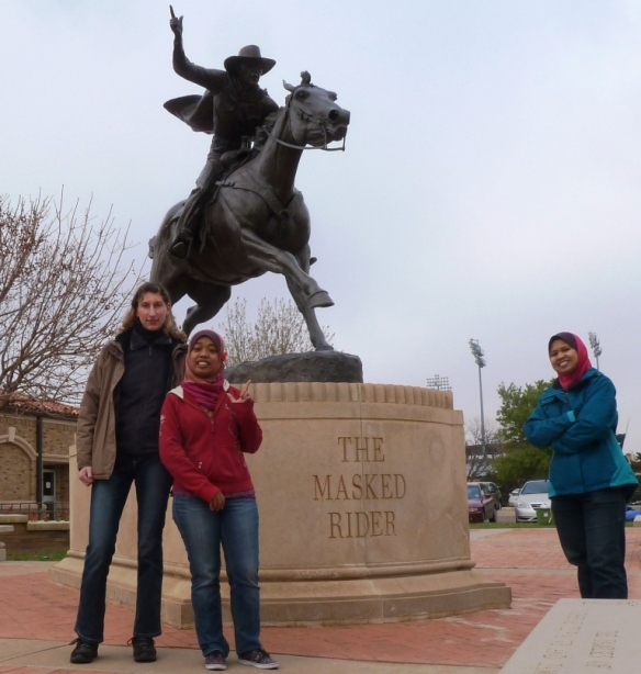 Guns up! On campus with Julie (left) and Ain (right)
