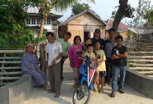 Joe in the field in Sumatra with coffee farmers (back row -- baseball cap).
