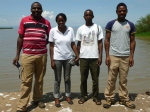 The Bat Team on the shores of Lake Victoria. Left to Right Dr Paul Webala, Beryl (Beryl Achieng Makori), Mike (Michael Bartonjo) and Simon (Wafula Simon Masika).