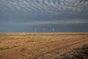 Treeless, waterless plain, where turbines abound